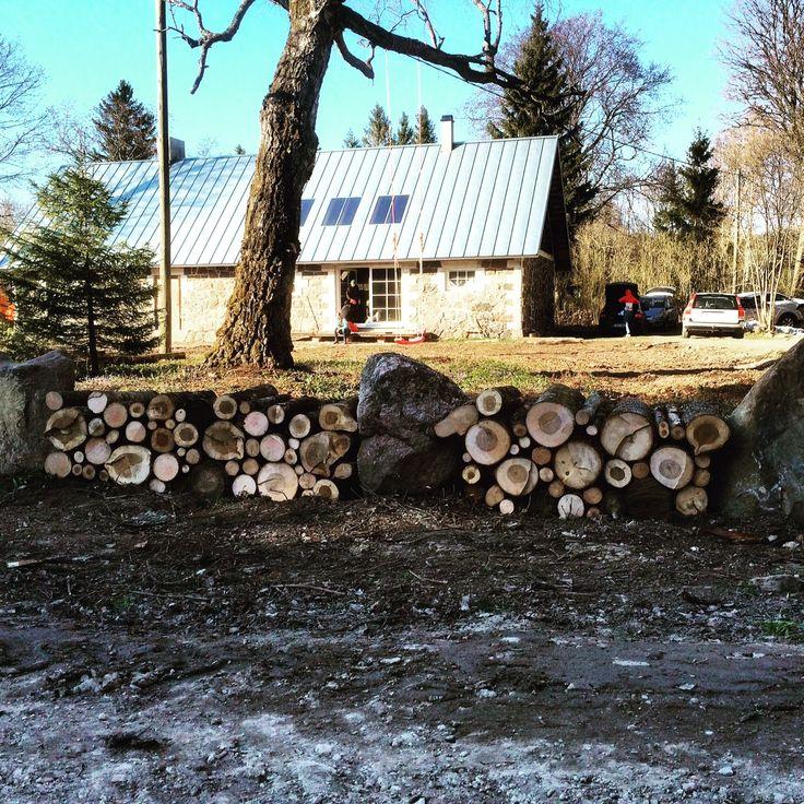 Rustic fence - big stones plus small full 20 inch logs in between! Topu, Läänemaa, Estonia.
