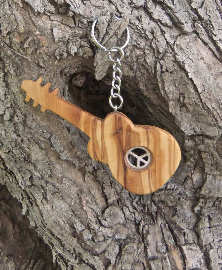Hand carved Greek Olive Wood  key chain guitar inlaid with peace sign by ellenisworkshop on Etsy