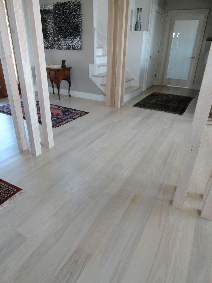 Elegant Laminate Grey Wood Floors With White Wooden Afro Decor