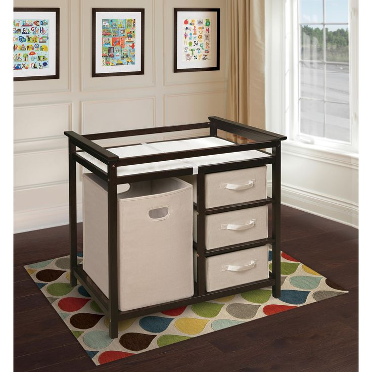 Complement the decor in your nursery with this functional, yet modern changing table. The quality constructed table is done in a sophisticated espresso finish and features a hamper and storage compartments underneath for added convenience.