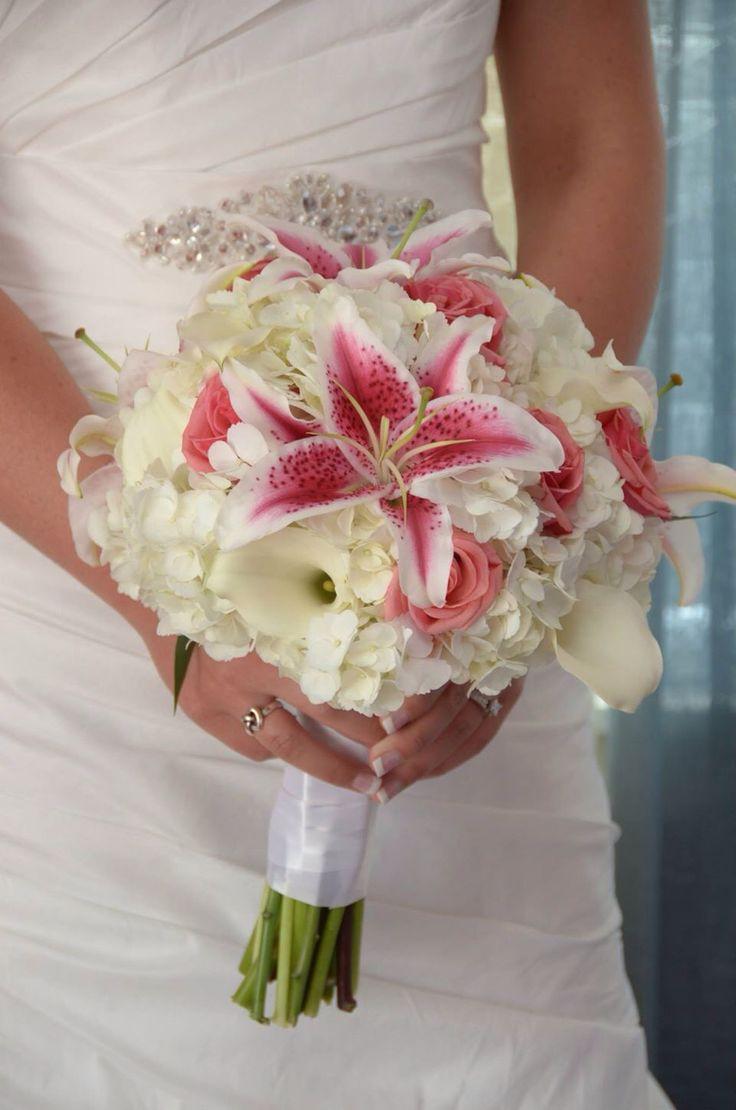 White Hydrangea, white Calla Lilies, Stargazer lilies, & coral roses