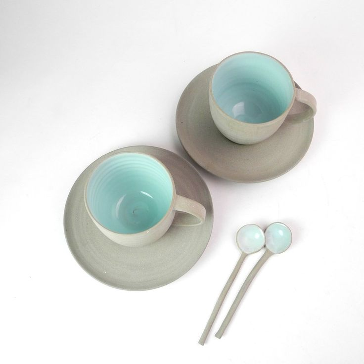 Cafe cups and saucers in grey and pastel mint. handthrown with home made grey stoneware clay and mint gloss glaze.
