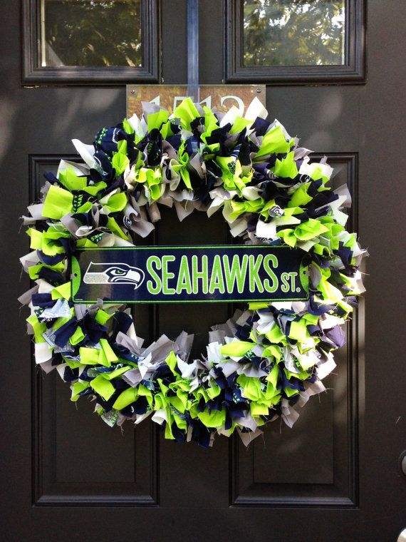 Hey Seahawks fans!    Show your team pride with this 16 fabric wreath. Its handmade using 5 different types of fabric. Navy, Green, White, Gray, and