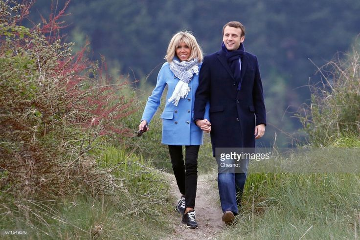 Head of the political movement En Marche! and candidate for the 2017 presidential election, Emmanuel Macron and his wife Brigitte Macron pose for a photograph on April 22, 2017 in Le Touquet, France. Macron is candidate for the France's 2017 presidential elections and polls predict his presence in the second round of this election.