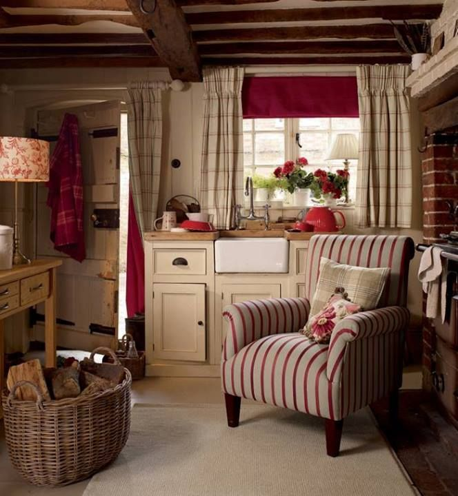 Cozy cottage style - note that there is a curtain rod with curtains over the door to insulate it in winter. What a great idea to avoid winter drafts!
