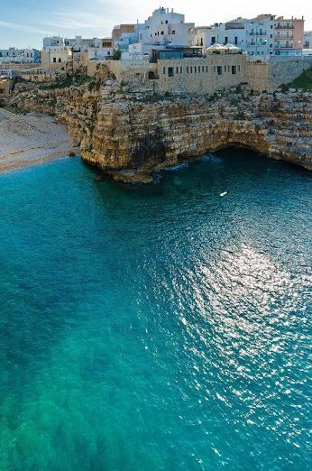 Polignano a Mare, Puglia, Italy - love the aqua colored sea www.traveloverseasnow.com