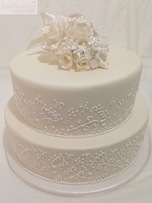 Elegant wedding cake. Hand piped lace. Hand made roses boquetcake topper keepsake.