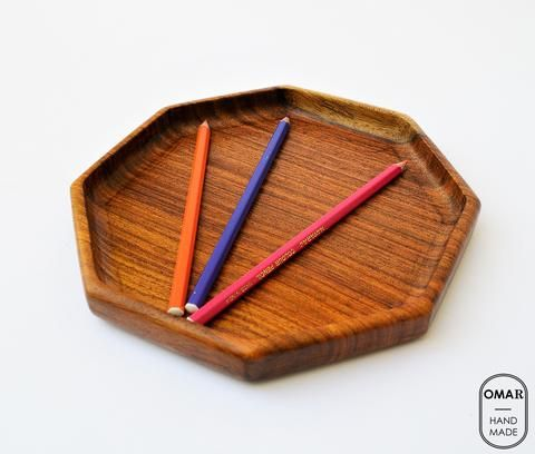 """Octagon Wooden key and wallet tray:  This Octagonal wooden plate is a valet tray for office and home.   Size: Width 20.5 cm (8"""") approximately. Material: 100% from tropical Hard Tali wood (No rain forest was harmed). Method: Hand-turning, Hand-carving, Finish: Olive oil."""