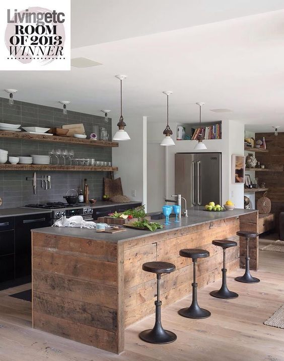 Nice kitchen with large peninsula, black cabinets and open wood shelves