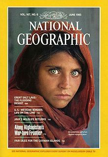 """Afghan Girl"" by Steve McCurry on the cover of the June 1985 issue of National Geographic."
