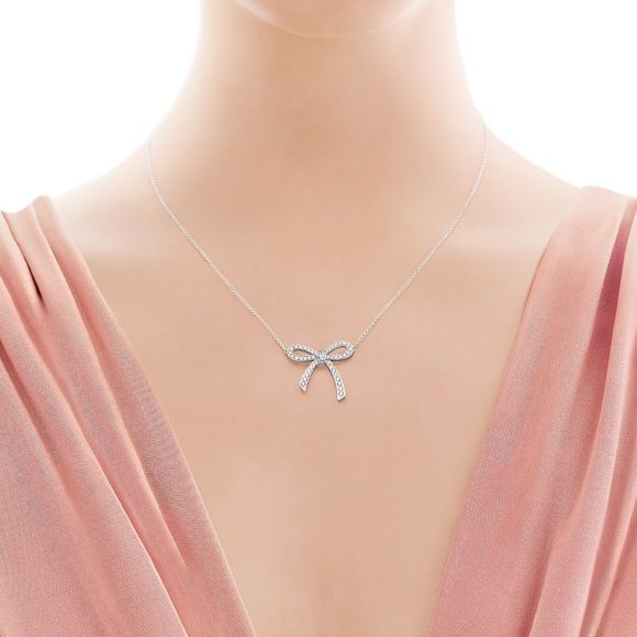 Pave Diamond Bow Necklace Pave Diamond Bow Necklace in silver and cubic zirconia. 19 inches in length. Adjustable length from 16 inches to 19 inches. Delicate and beautiful. Anthropologie Jewelry Necklaces