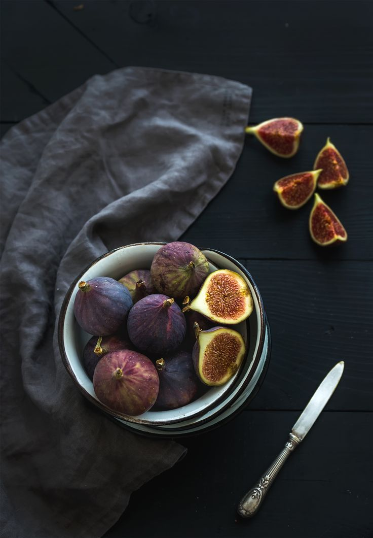 Rustic metal bowl of fresh figs on dark background, top view, selective focus. - Rustic metal bowl of fresh figs on dark background, top view, selective focus