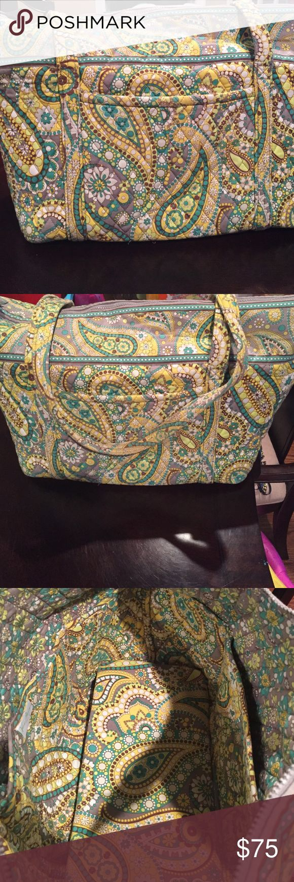 Vera Bradley overnight bag Vera Bradley overnight bag. Has front pocket. Inside has 6 pockets great for storage. Very good condition. Vera Bradley Bags Travel Bags