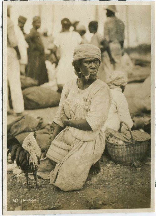 A Jamaican market seller (Circa 1920) ( via ). How bad is she?