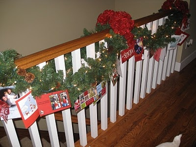 Display Christmas Cards in the garland on the stairs