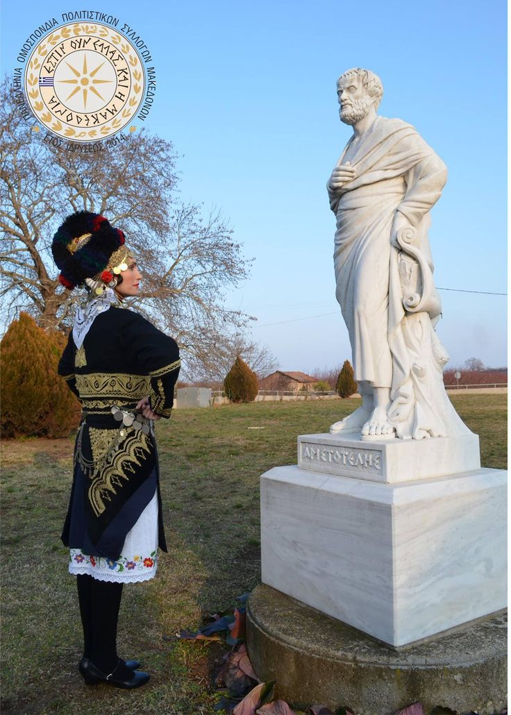 A #macedonian lady wearing the #greek #traditional #costume of #Roumlouki stands in front of #Aristotle's statue  #photography #panhellenic Federation of #cultural Associations of #macedonians | #Culture #folk #dances #Macedonia #Greece