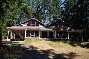 9374 Stittle Road Powell River BC – Complete the Dream – Executive style, custom designed & built. 1750 sq.ft. on main, 1100 sq. ft. on the upper.  In-lay heating with fir flooring in dining room, sunken formal living room & family room.  Tiled kitchen, utility & bathrooms. 3 bedrooms, office off master with ensuite, (needs some finishing materials available to complete).  Detached shop & 2 bedroom. Yard has lawn areas, large fir trees, room for gardens. Less than 10 km from town.