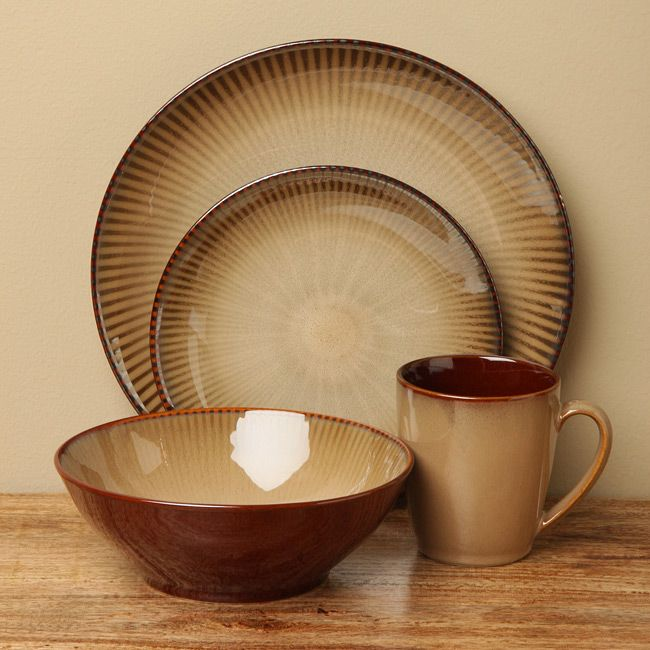 Set your table with a casual but attractive set of dishes with the focus brown dinnerware set from Sango. The 16-piece set of microwavable Sango dinnerware includes four dinner plates, salad plates, soup bowls and mugs.