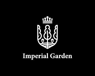 Imperial Garden Logo Design  Heraldic golden logo that features a few trees with flowers and a crown on top. It looks like a shield.