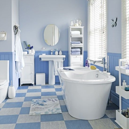 Blue bathroom. Paint bathroom walls two subtle but contrasting shades of blue for a fresh look. Pale tones have the same light-boosting effect as white, but without being bland. #bathroom #toilet #shower