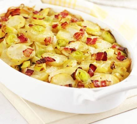 Leek, potato & bacon bake Ingredients  600ml chicken or vegetable stock 1kg potatoes, thinly sliced 6 leeks, thinly sliced into rounds 25g butter 3-4 rashers streaky bacon, snipped 3 tbsp double cream (optional)