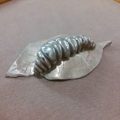 This gorgeous #caterpillar on a leaf, 2 piece table ornament was lovingly #handcarved by #Tara Shelton and cast into #sterling silver. Price $650.00 CDN. See more of #artisan Tara Shelton's #jewelry #jewellery at #ArtisansAtWork/ #AAWGallery www.aawgallery.com and www.tarashelton.com