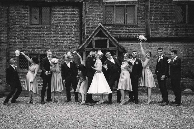 Getting your bridal party to relax and have some fun in the group shots can end up looking like this! @LillibrookeMnr Photo by Benjamin Stuart Photography #weddingphotography #bridalparty #groupshot #blackandwhite #justmarried #lillibrookemanor