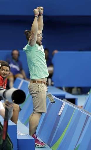 Shane Tusup, the husband of Hungary's Katinka Hosszu, celebrates after she wins…