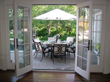 exterior french doors with stationary doors on side I would remove the functioning doors and just have the stationary doors to create a seperate space but still be open (dining off kitchen or living)