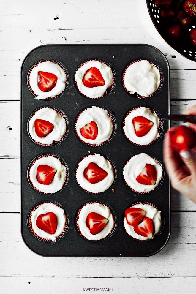 White cupcakes with strawberries -angel food cupcakes so they are like strawberry shortcake?