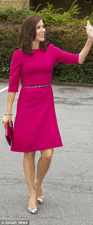 Power princess: Mary stood out from the crowd in a hot pink dress, matching clutch and snakeskin stilettos for a hospital and school visit in Denmark in September