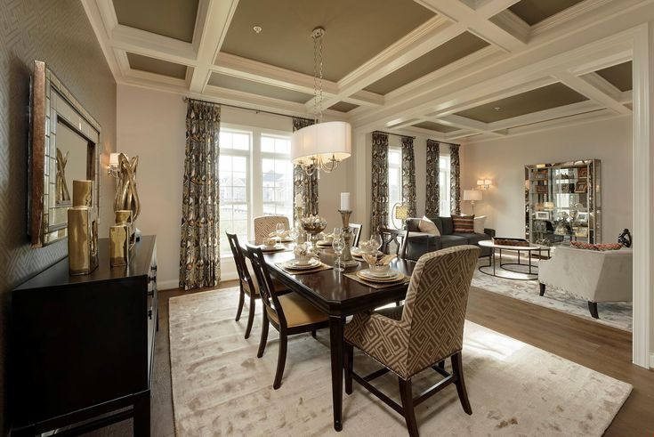 A dramatic coffered ceiling defines this dining room and living area. The Hawthorne plan, a new home in Westland Farm estates built by Williamsburg Homes. Fulton, MD.