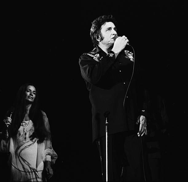 Johnny Cash performs live on stage with his wife June Carter in Amsterdam Netherlands 11th April 1976