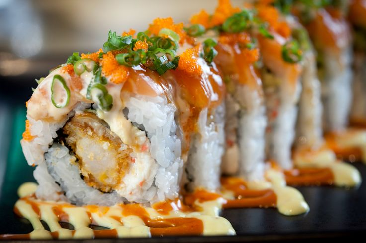 Mikuni James Roll- Salmon, eel, cucumber, avocado, panko shrimp, crab mix, cream cheese, Spicy Dream sauces, masago and onion