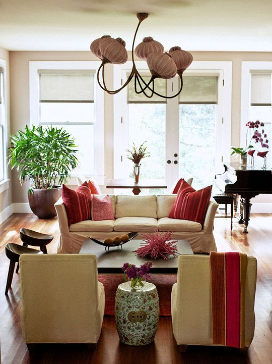 The living room's light fixture is as artful as the red ceramic sculpture on the coffee table.