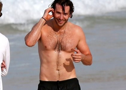 """Bradley Cooper: Shirtless in Rio! -                                     Giving beachgoers a little extra thrill,  Bradley Cooper showed up on the Rio de Janeiro shore sans shirt this morning (May 29).  The """"Limitless"""" hunk looked handsome as he t"""