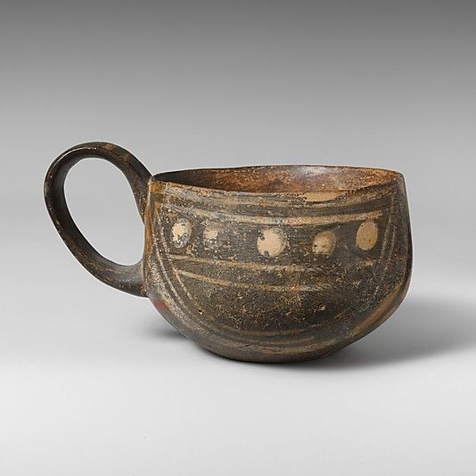 Terracotta one-handled cup  Period: Middle Minoan I Date: ca. 2200-1900 B.C. Culture: Minoan Medium: Terracotta; White-on-dark ware Dimensions: H. 2 5/16 in. (5.9 cm.) Diameter 3 1/4 in. (8.3 cm.)