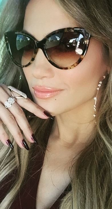 Who made  Jennifer Lopez's brown cat sunglasses and diamond hoop earrings?