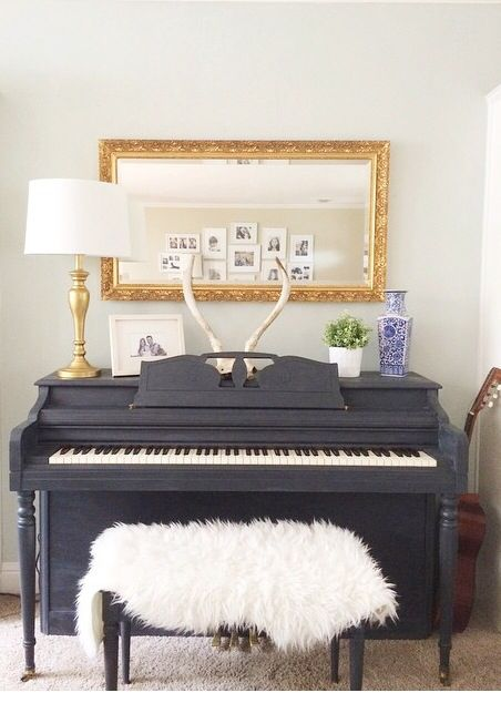 Annie Sloan chalk painted piano. Dark navy, gold, antlers visit sosimplydesign on Instagram.