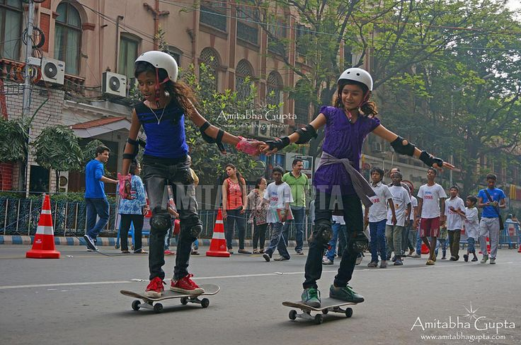 "Girls on Skate Board at ""Happy Streets"" 