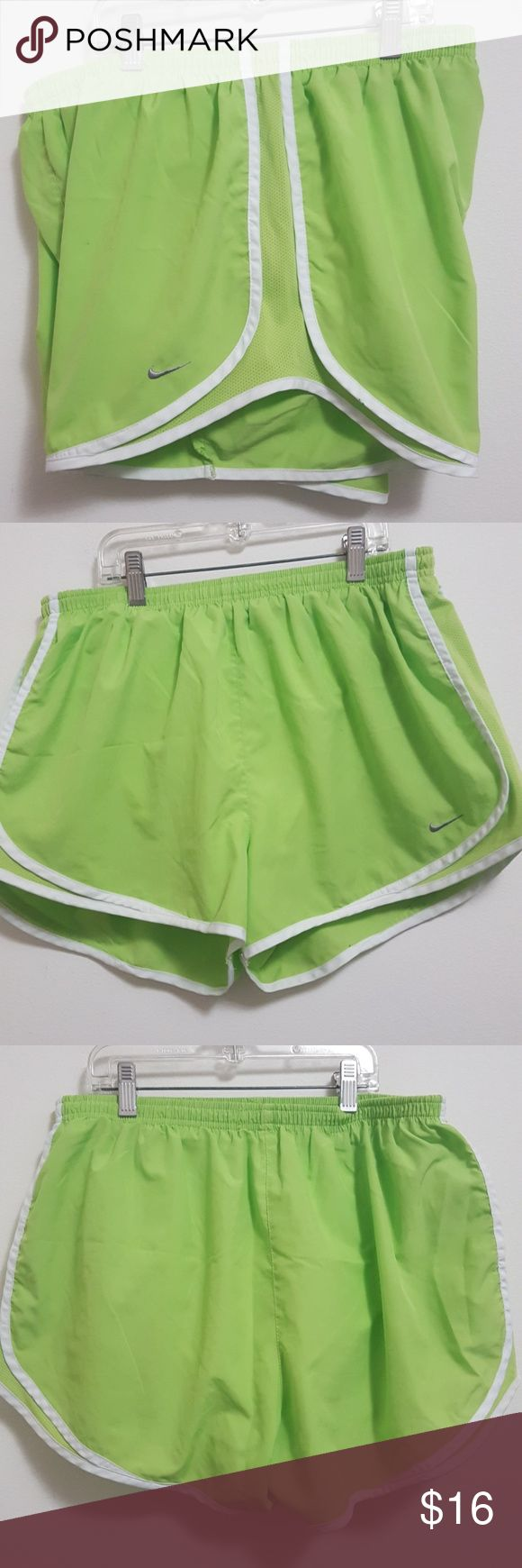 Nike FITDRY running shorts VERY GOOD CONDITION! Size extra large. Very minor flaw (very tiny pen mark in front. It's very small dot).  Lime green shorts with white trim.Has white inner lining with inner pocket in the front. Gray embroidered nike swoosh in bottom left corner.  Great for workout shorts or any active activity.   No trades. Bundle to save on shipping!  Offers are welcomed through offer button only. Nike Shorts