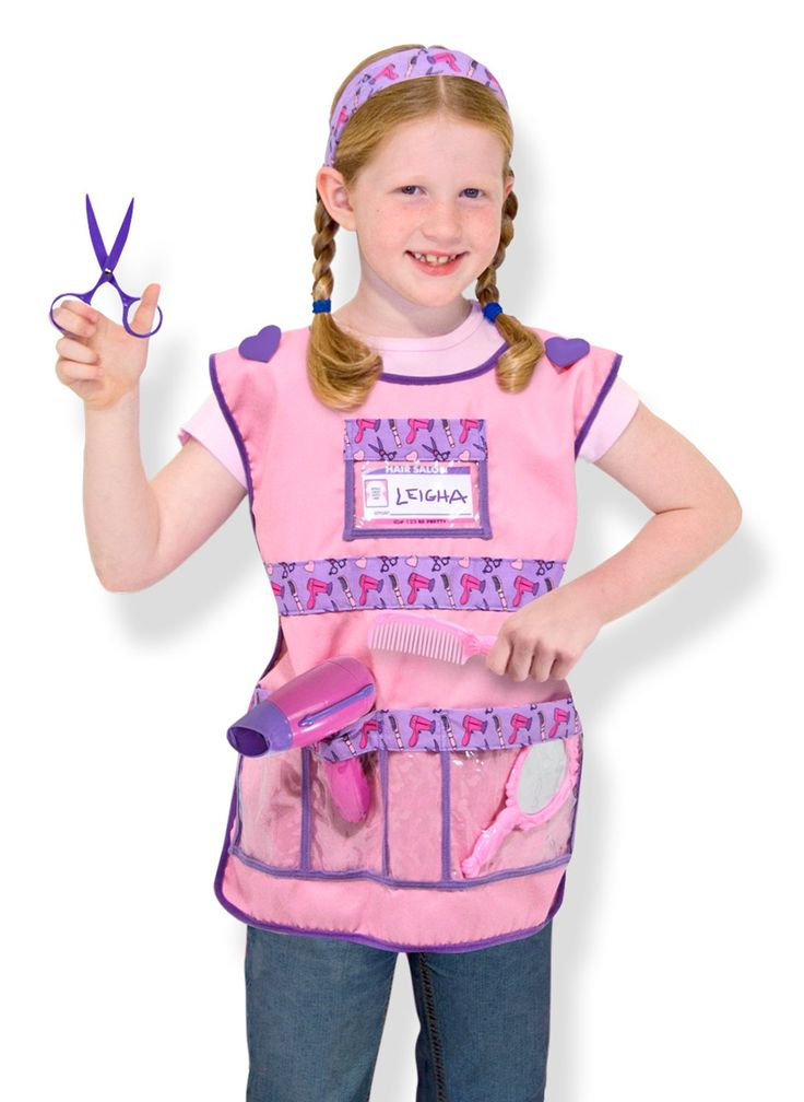 """Melissa & Doug Hair Stylist Costume Role Play Set. Young stylists can brush, comb, cut and curl with this set. High-quality fabrics and construction ensure durability. Includes cool-blowing hair dryer, non-cutting scissors, headband and plastic hand mirror. Machine-washable costume and wipe-clean accessories. 17"""" x 21"""" x 5"""" pkg; Ages 3-6; AAA batteries not included."""