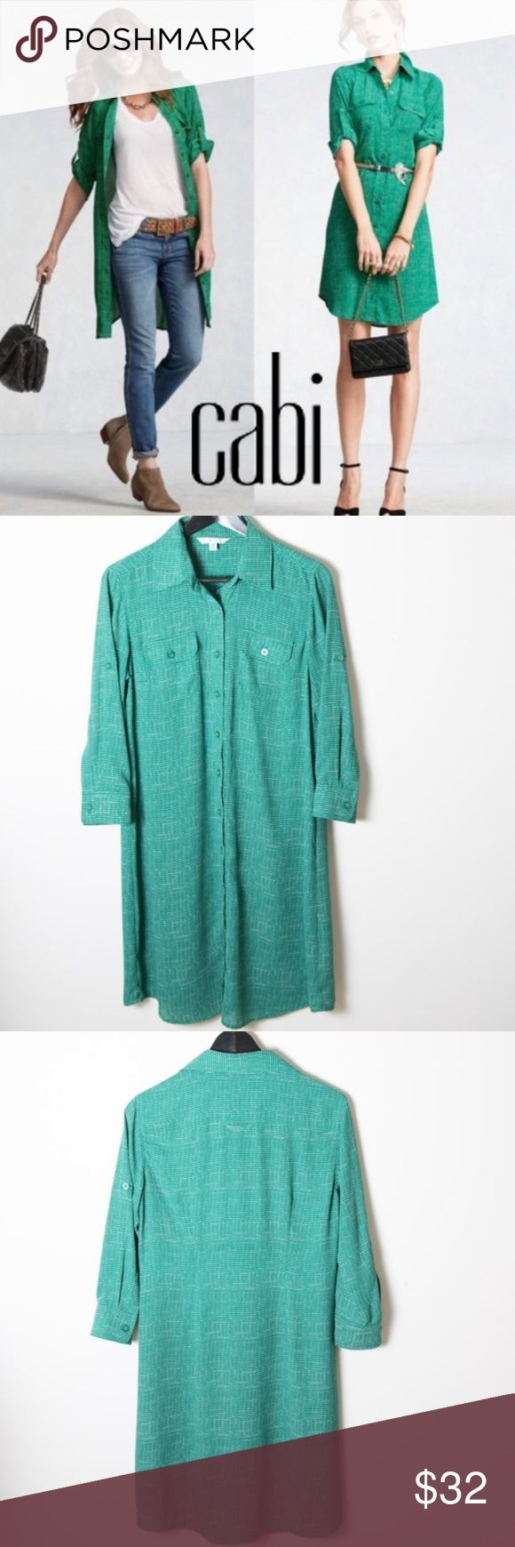 CAbi Kelly Green Shirt Dress #429 Med Knee Legnth CAbi medium shirt dress. Style # 429. Button down with collar, unlined. Front pockets. Long sleeves with button tab roll cuff to wear up or down. This shirt dress is missing the matching belt. Polka dot like pattern in white and a kelly or emerald green shade. Knee length or above the knee depending on height. Good preloved condition. No noticeable holes, stains or rips. So many ways to wear this - as a dress or layered for a casual look…