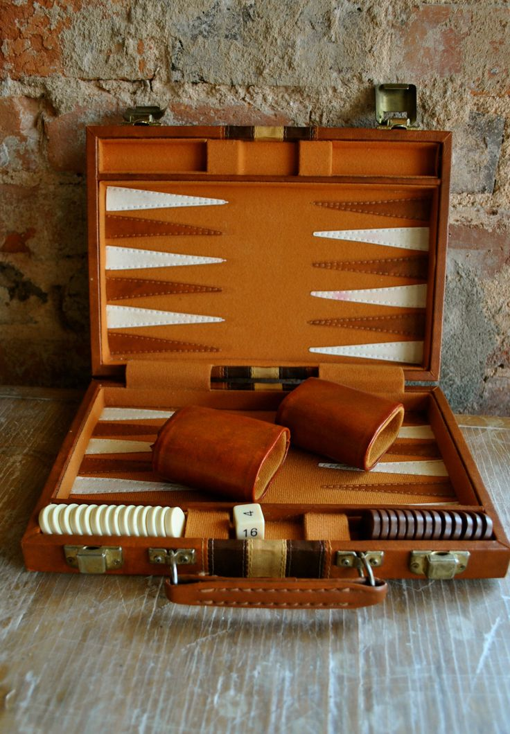 Backgammon always reminds me of my one grandma. When I would go over to her apt when I was little my relatives would play this.