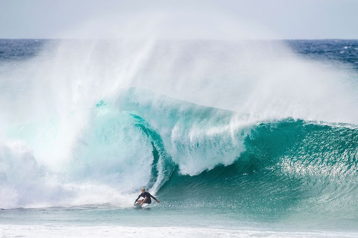 """Mick Fanning Surfing in North Shore, Oahu, Hawaii, USA.  - Mick Fanning Surfing in North Shore, Oahu, Hawaii, USA.  Trevor Moran / Red Bull Content Pool <a href=""""https://www.redbullphotography.com/editors-choice/1418734017160-152206048"""">Red Bull Photography</a>"""