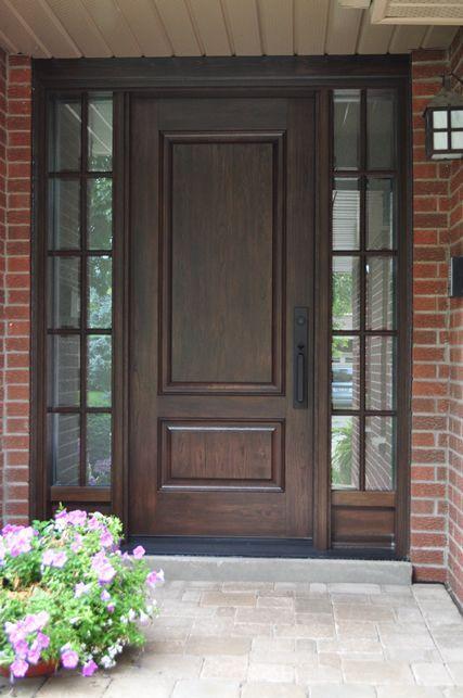This stained woodgrain fiberglass door system gives a classic, traditional feel to this home.  www.doorwayinc.ca Burlington, ON #doors #burlington #doorway