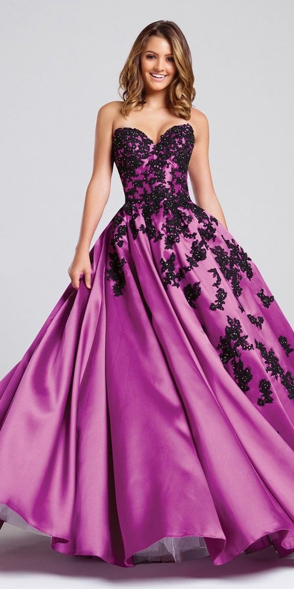 S - Tried this one on today and it looked pretty good.  A bit more formal than I was going for maybe and seemed a darker pink/purple/magenta in the store.   Ellie Wilde for Mon Cheri Ball Gown