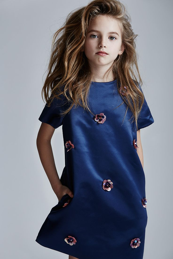 Model Maisie in a midnight blue satin party dress with embroidered detail from MSGN fall 2015 kidswear collection