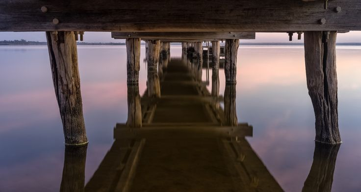 """- R i v e r l a n d - - Early to bed, early to rise...Lake Bonney, Barmera. Thought I'd get the old """"under the jetty shot"""", although this is a rather small jetty and I had to crawl my way to the underside of this...3 years ago I started my photographic journey here..nice to return to this peaceful place."""