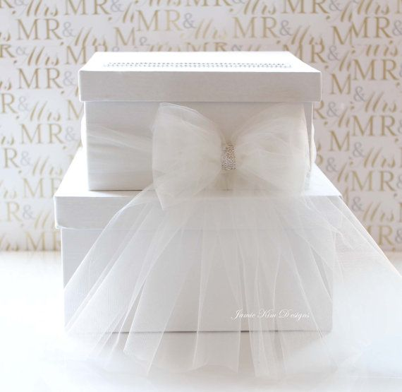 Can make it yourself and save $98. Just 2 simple white boxes with a hole cut in the top. Trimmed in rhinestones. Use tulle to make a bow and glue rhinestones in the middle to finish the look. Easy!!!